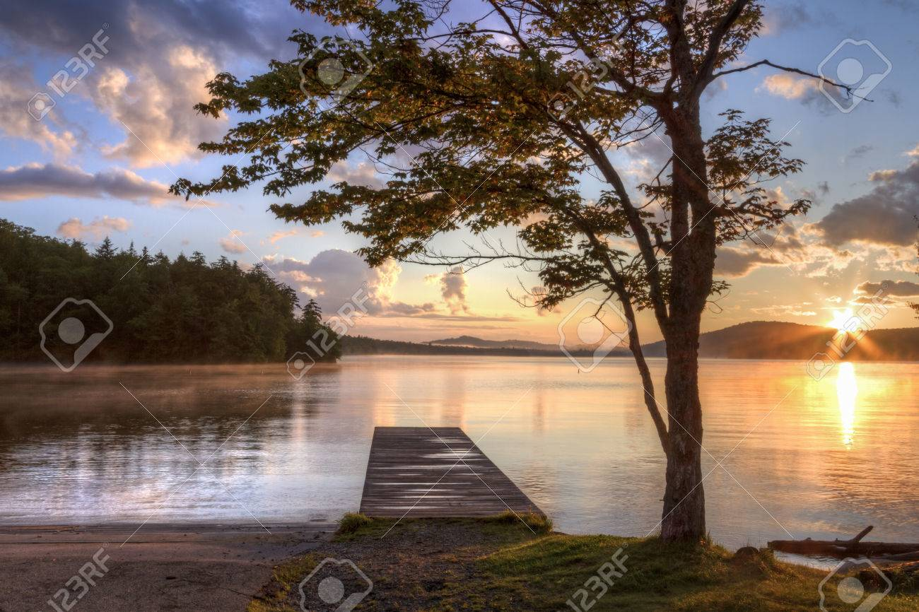 Sunset on the shore of Seventh Lake in the Fulton Chain Lakes region of the Adirondack Mountains of New York - 33631907