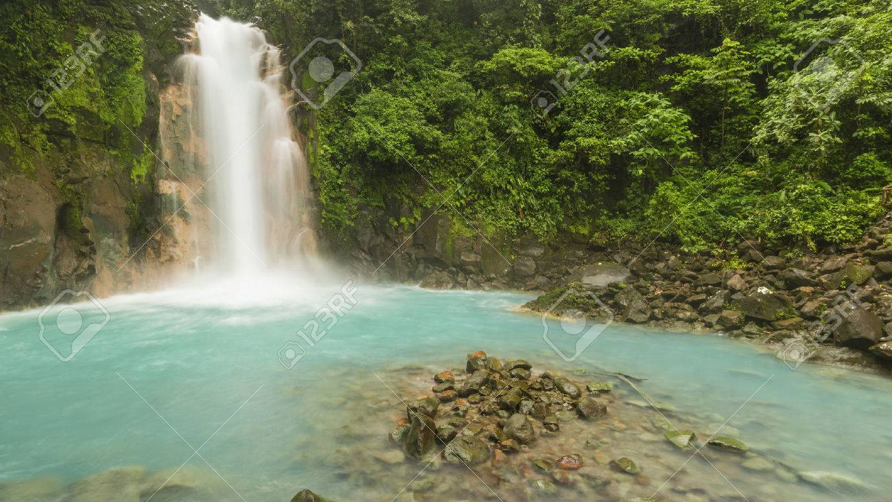 Panoramic image of the cerulean blue waters of the Rio Celste Waterfall in Volcan Tenoria National Park, Costa Rica. - 34043192