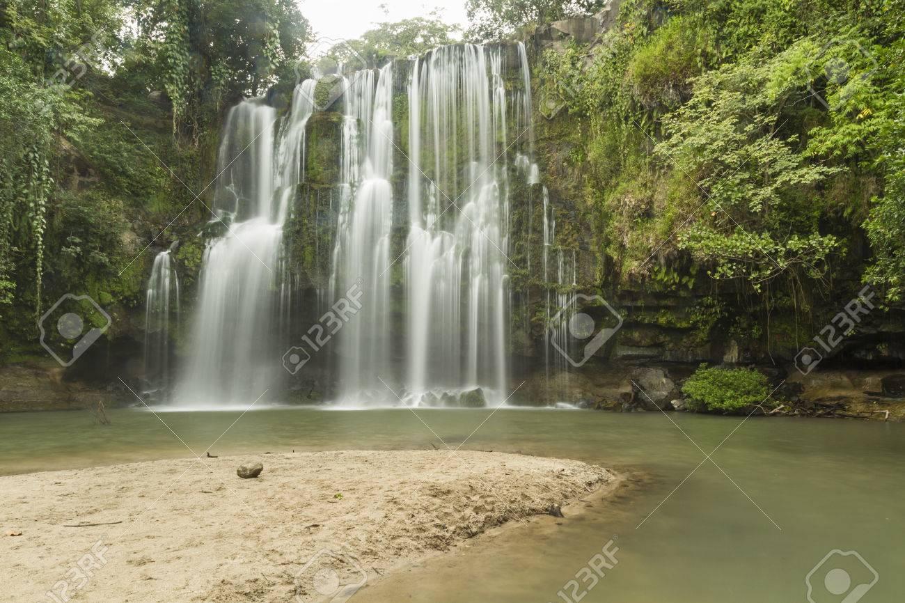 A sandy beach at a popular swimming hole at Llanos de Cortés waterfall near Bagaces, Costa Rica - 34829338