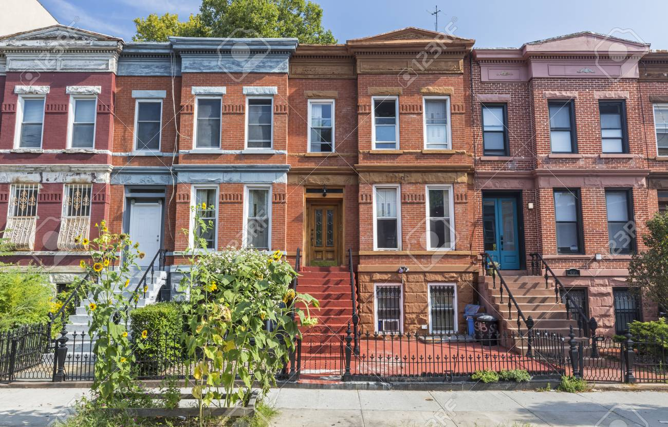 brick apartment building. A row of brick apartment building on Union Street in the Crown Heights  Neighborhood Brooklyn Row Of Brick Apartment Building On In The