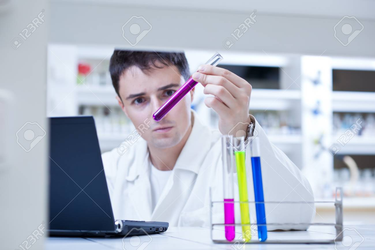 close-up portrait of a young male researcher carrying out experiments in a research lab (color toned image; shallow DOF) Stock Photo - 9697246