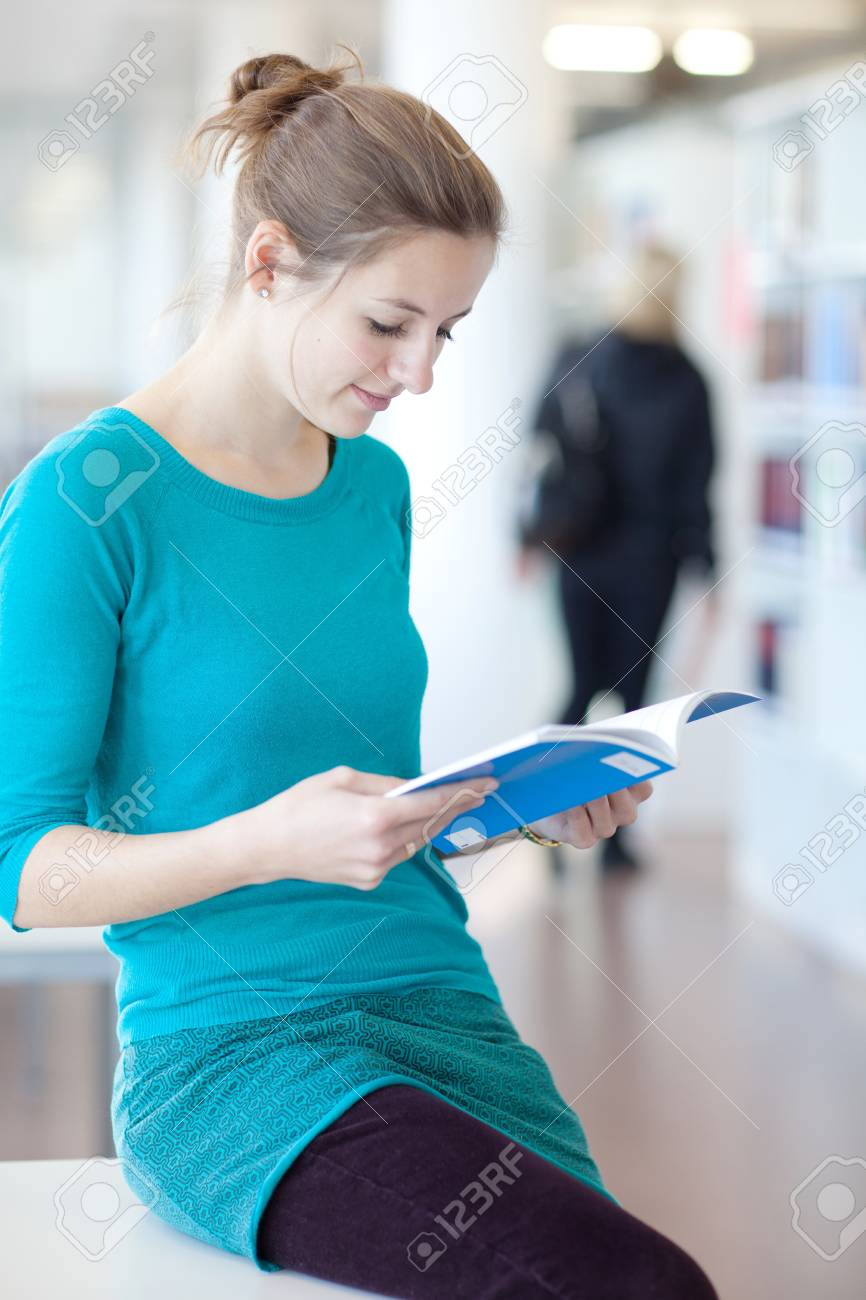 pretty young college student in a library Stock Photo - 9792060
