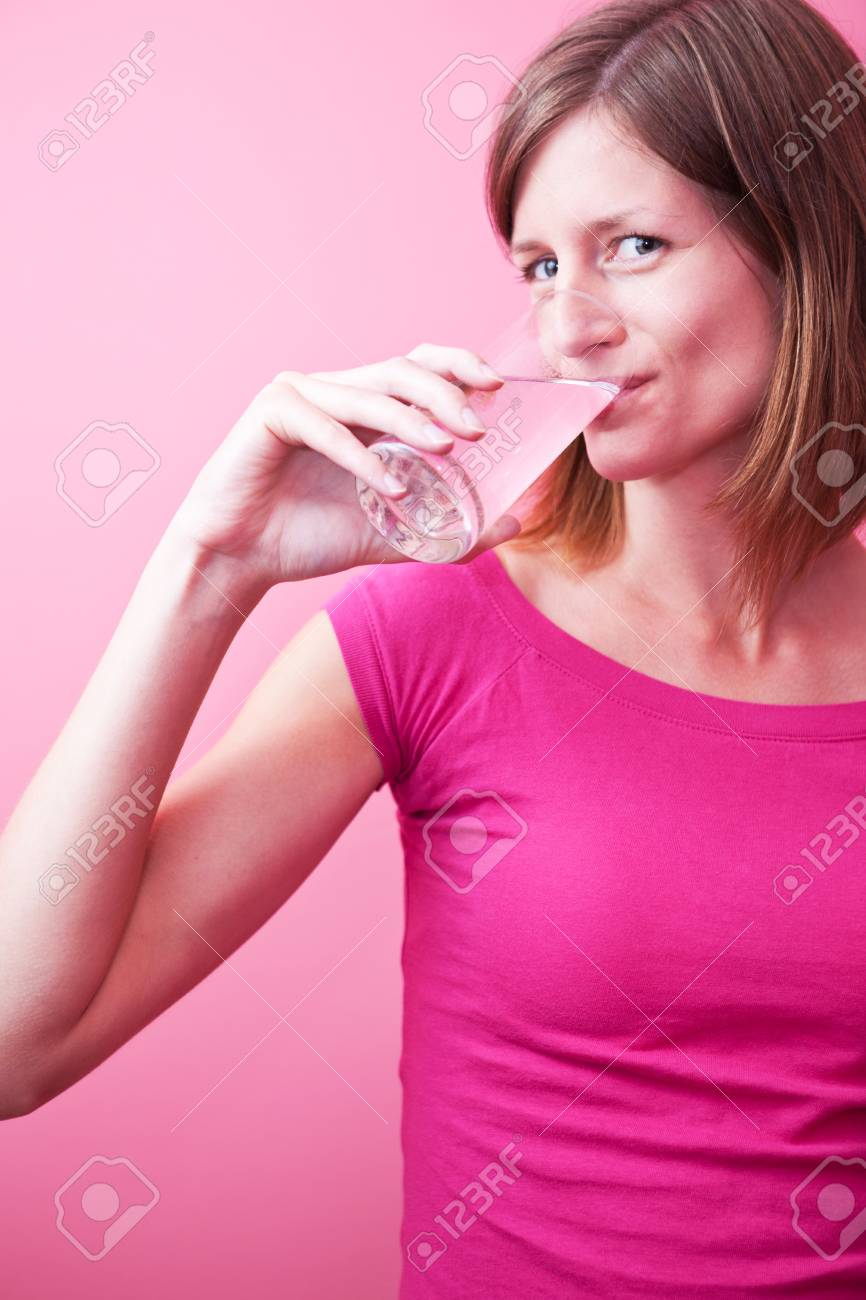 pretty, young woman drinking fresh water from a glass (color toned image; shallow DOF) Stock Photo - 9798954