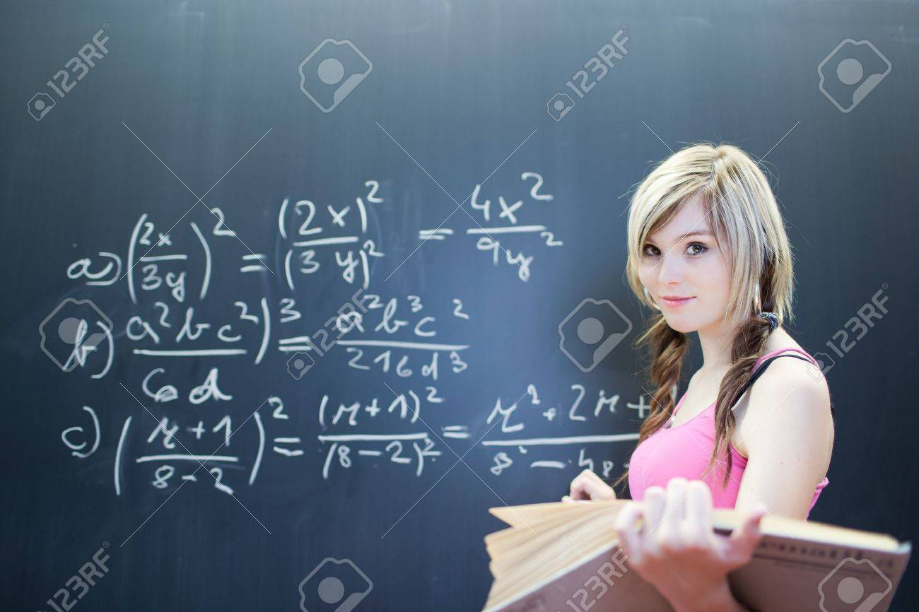 Pretty Young College Student Writing On The Chalkboard/blackboard ...