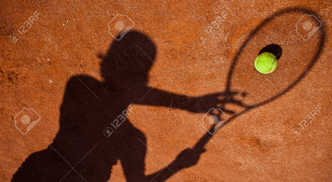 shadow of a tennis player in action on a tennis court Stock Photo - 10119611