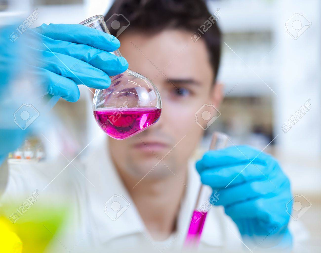 young male researcher carrying out scientific research in a lab Stock Photo - 9939913