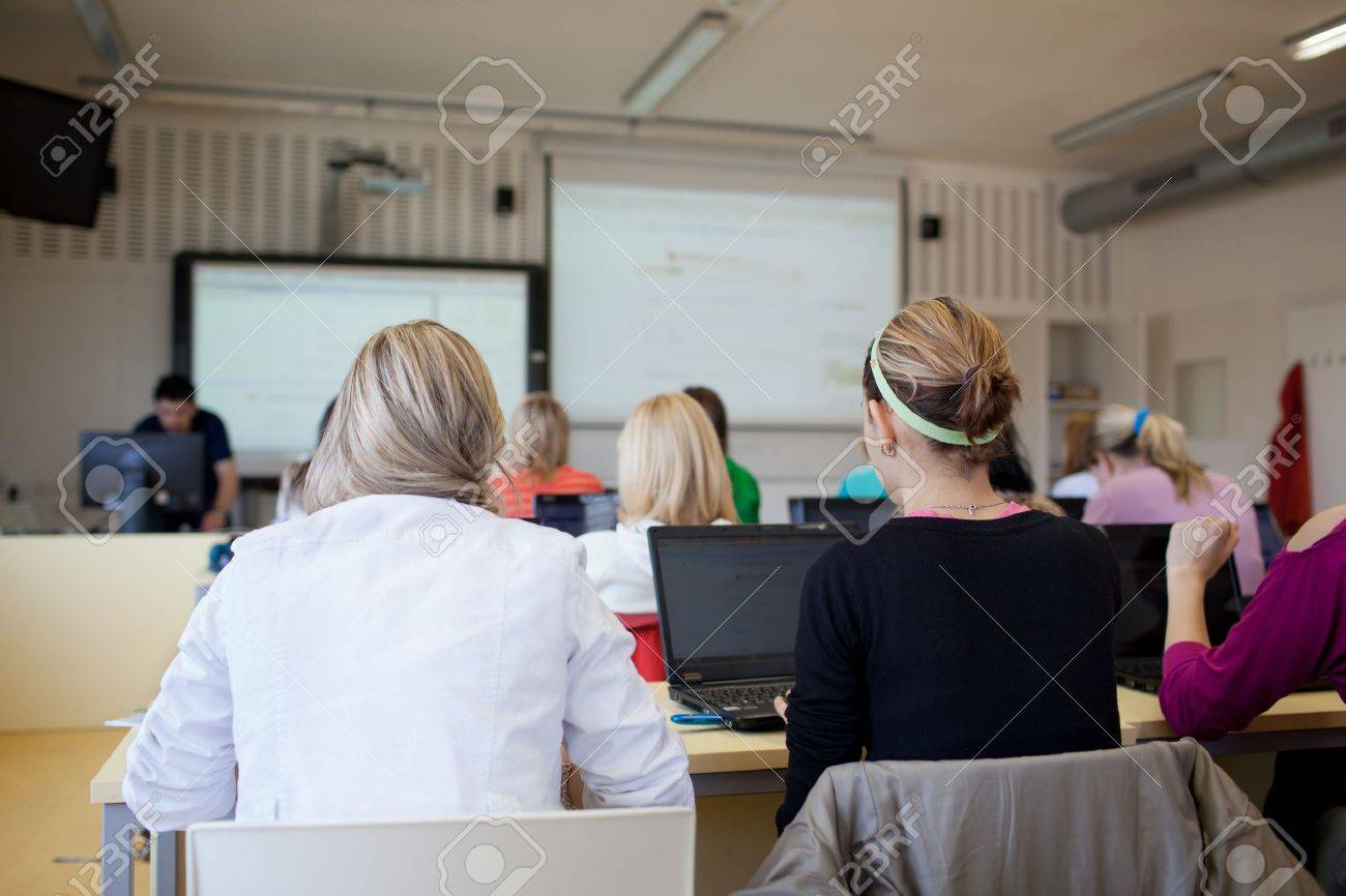 college students sitting in a classroom, using laptop computers during class (shallow DOF) Stock Photo - 10409985