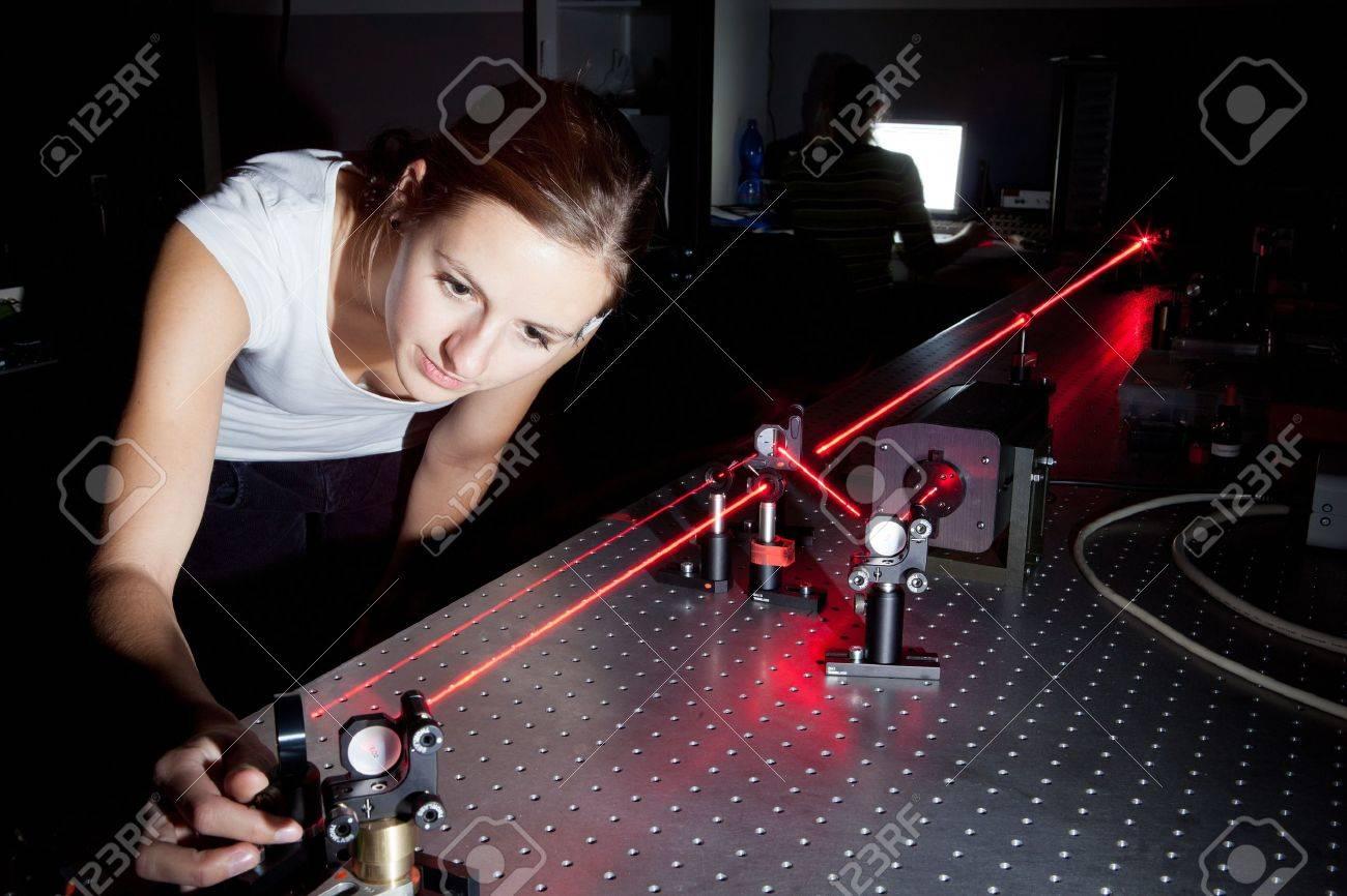 female scientist doing research in a quantum optics lab - 10575899