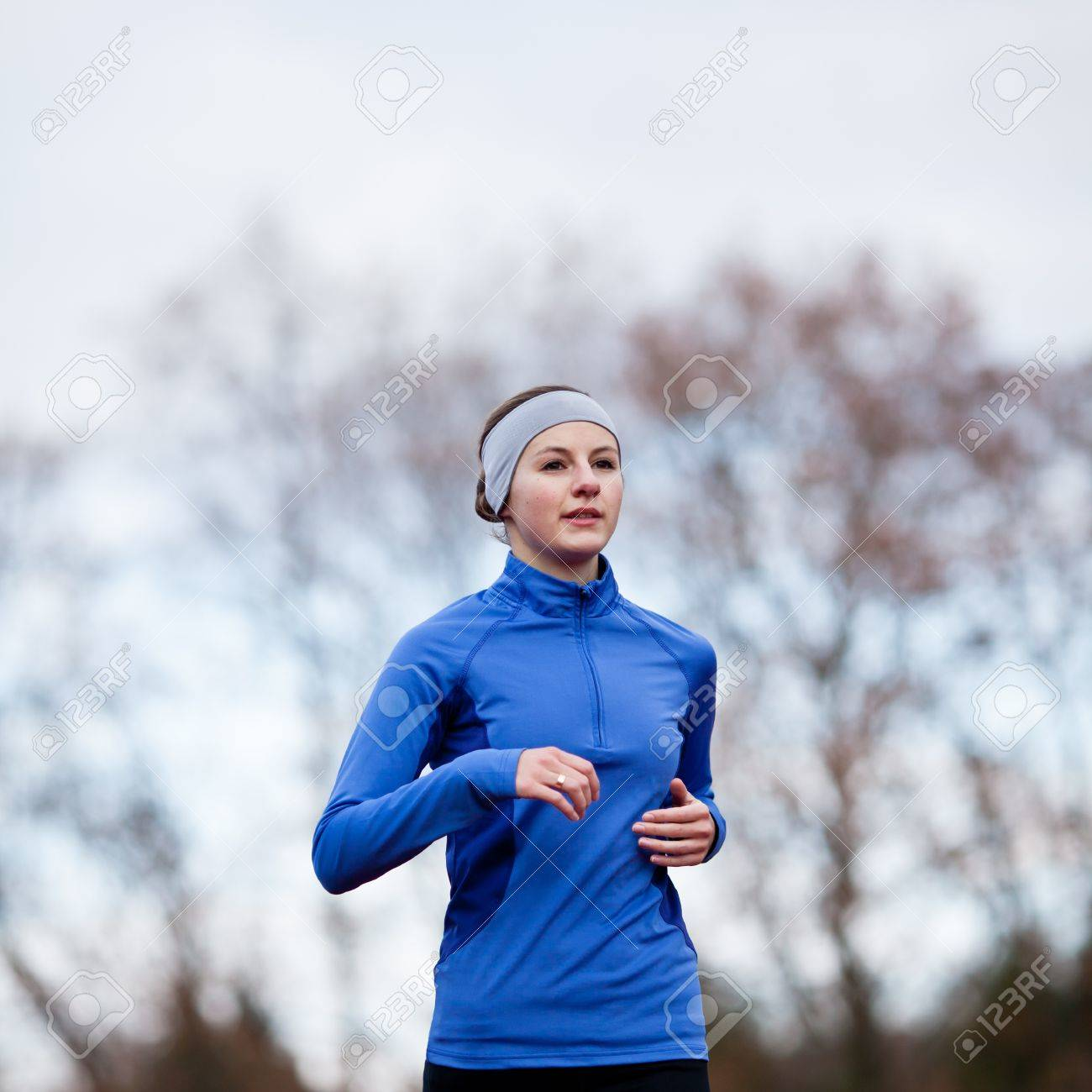 Portrait of a woman running against against blue sky Stock Photo - 11940440