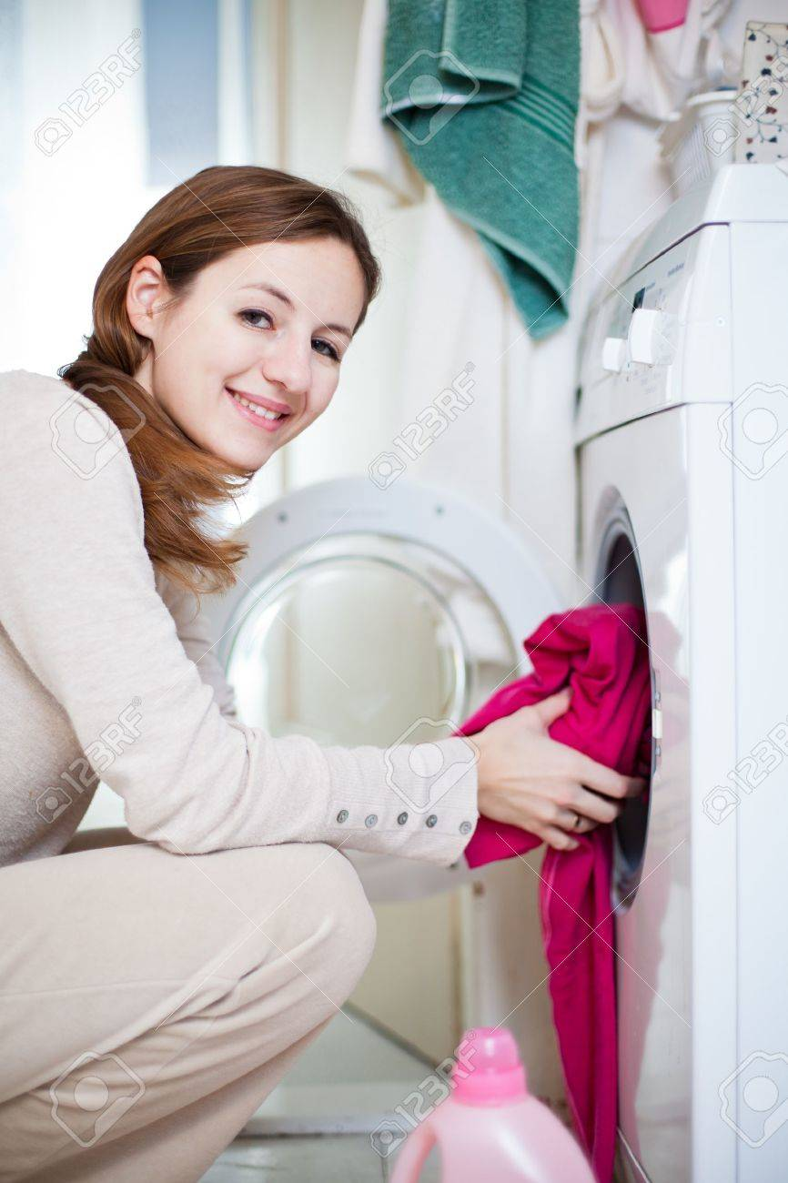 Housework: young woman doing laundry (shallow DOF; color toned image) Stock Photo - 12116199
