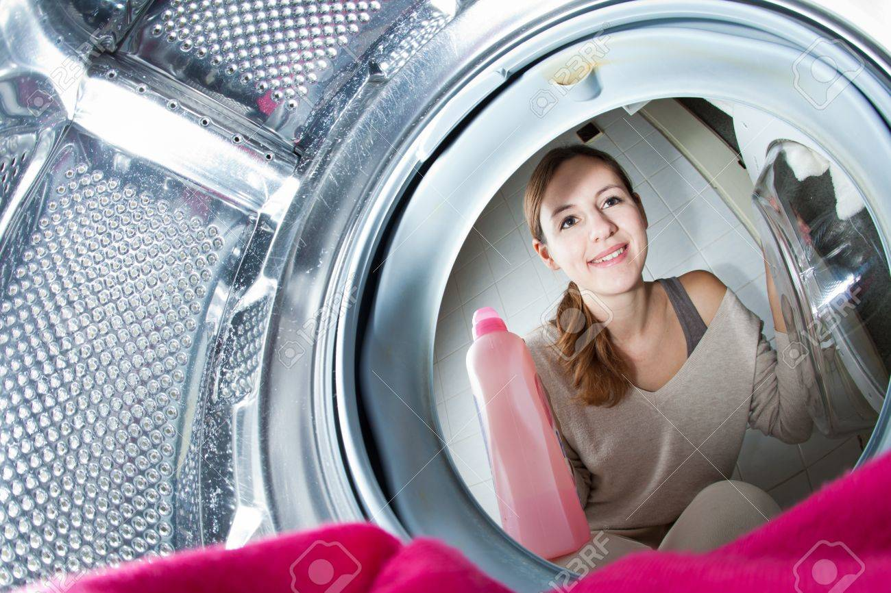 Housework: young woman doing laundry (shallow DOF; color toned image) Stock Photo - 12120865