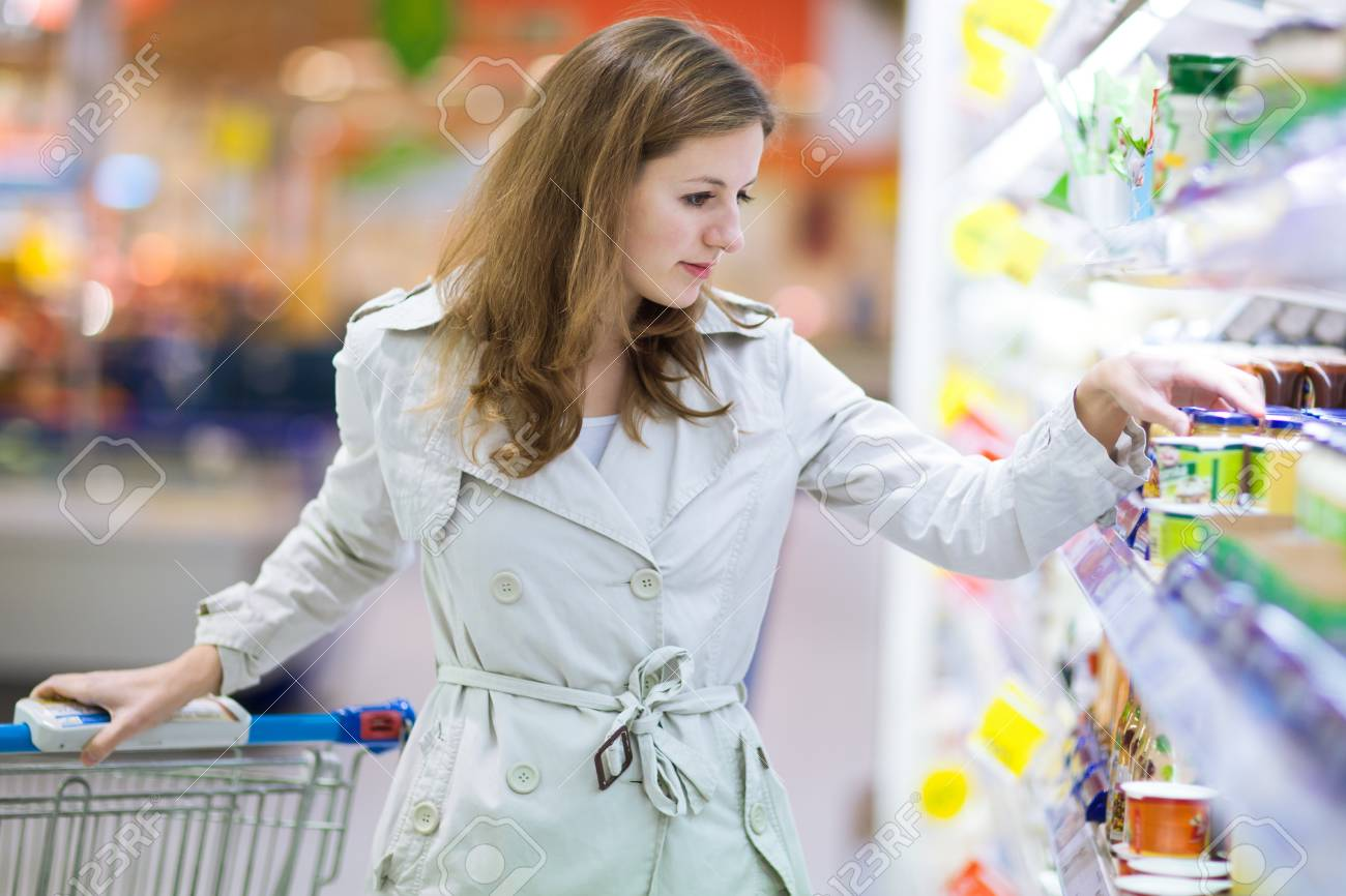 Beautiful young woman shopping for fruits and vegetables in produce department of a grocery store/supermarket Stock Photo - 12116184