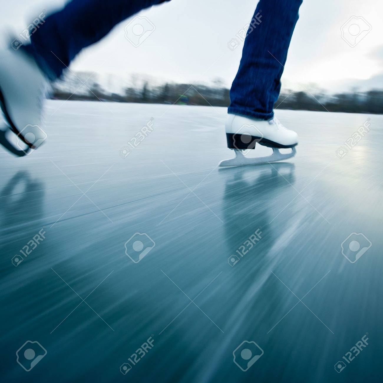 Young woman ice skating outdoors on a pond on a freezing winter day Stock Photo - 12405937