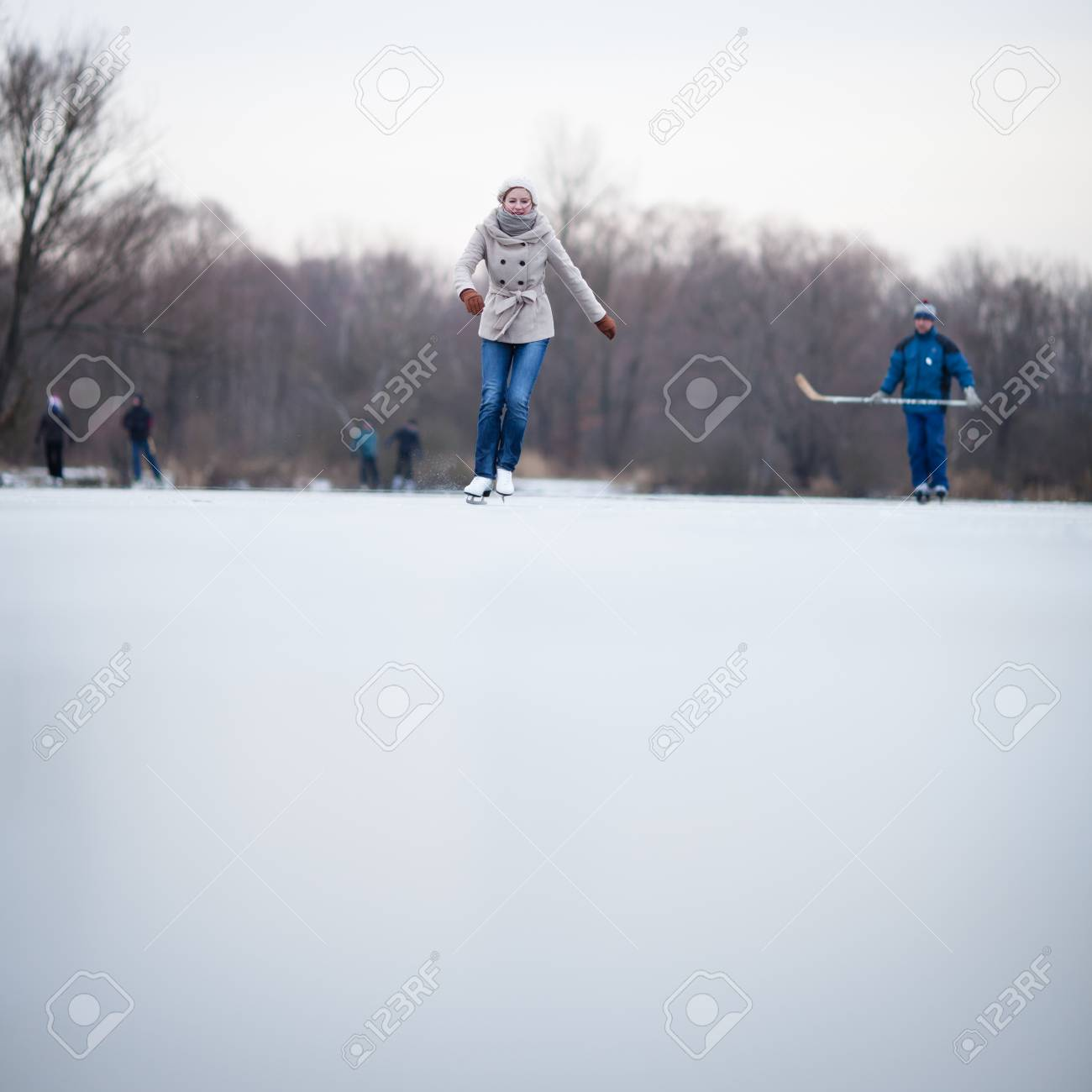 Young woman ice skating outdoors on a pond on a freezing winter day Stock Photo - 12405836