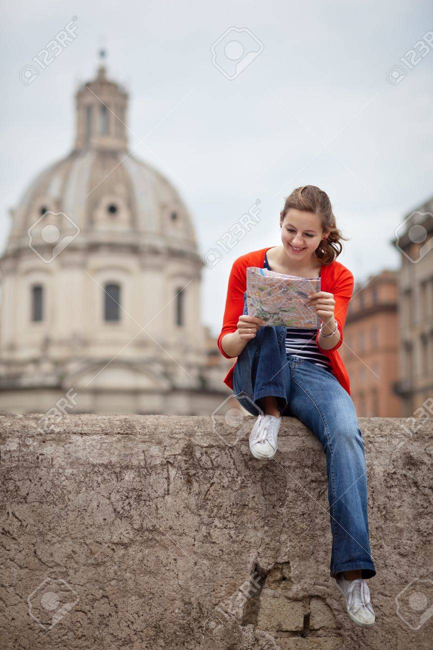 Pretty young female tourist studying a map at the Trajan Stock Photo - 12636891