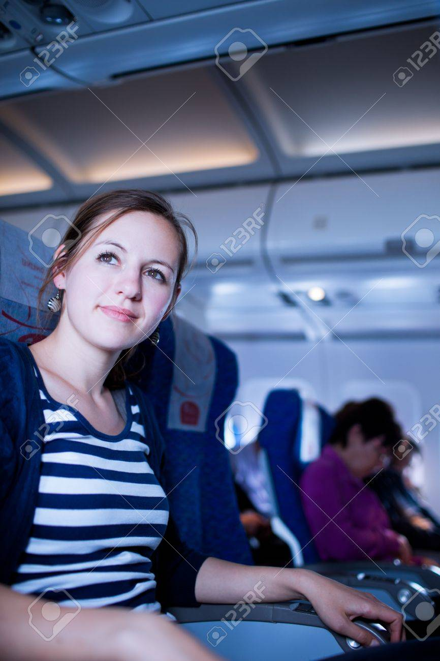 Pretty young female passenger on board of an aircraft  color toned image Stock Photo - 12636797