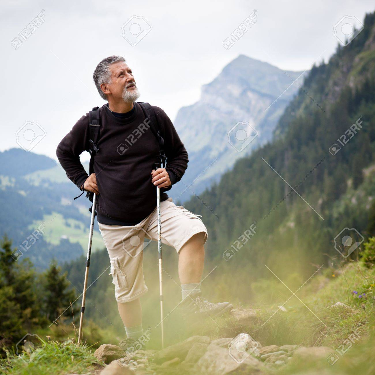Active senior hiking in high mountains (Swiss Alps) Stock Photo - 12637188