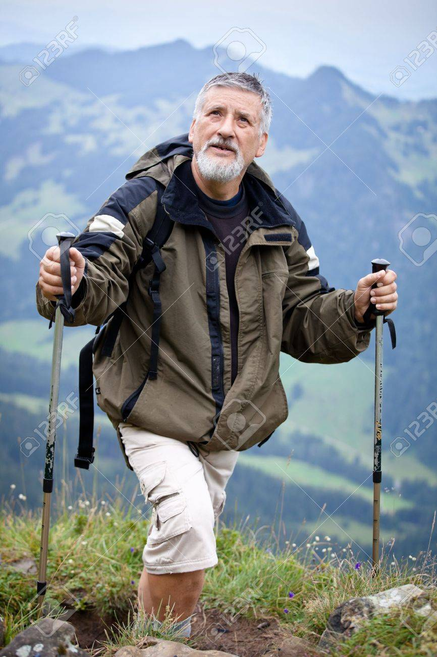 Active senior hiking in high mountains (Swiss Alps) Stock Photo - 12638043
