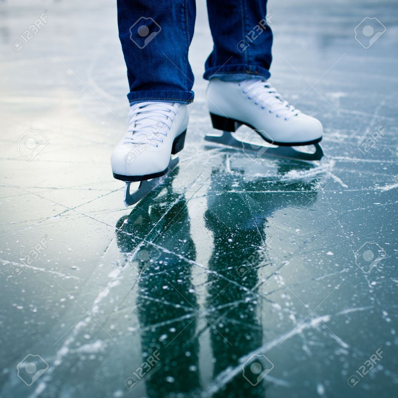 Young woman ice skating outdoors on a pond on a freezing winter day - detail of the legs Stock Photo - 12808633