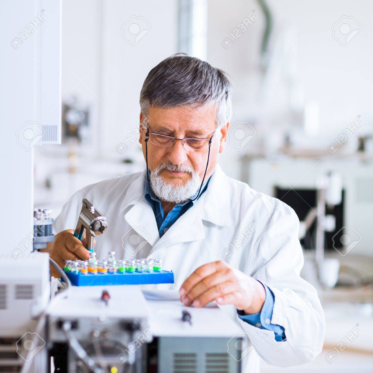 senior male researcher carrying out scientific research in a lab using a gas chromatograph (shallow DOF; color toned image) Stock Photo - 13444735