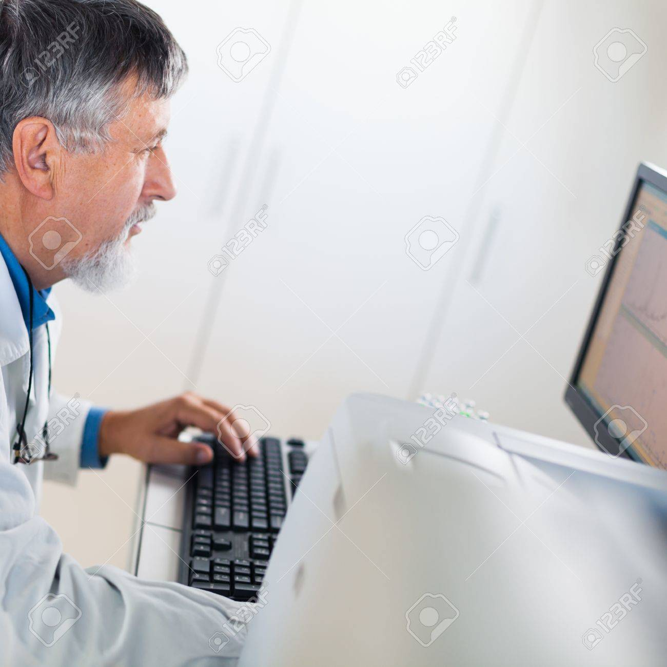 Senior researcher using a computer in the lab while working on an experiment (color toned image) Stock Photo - 13444666
