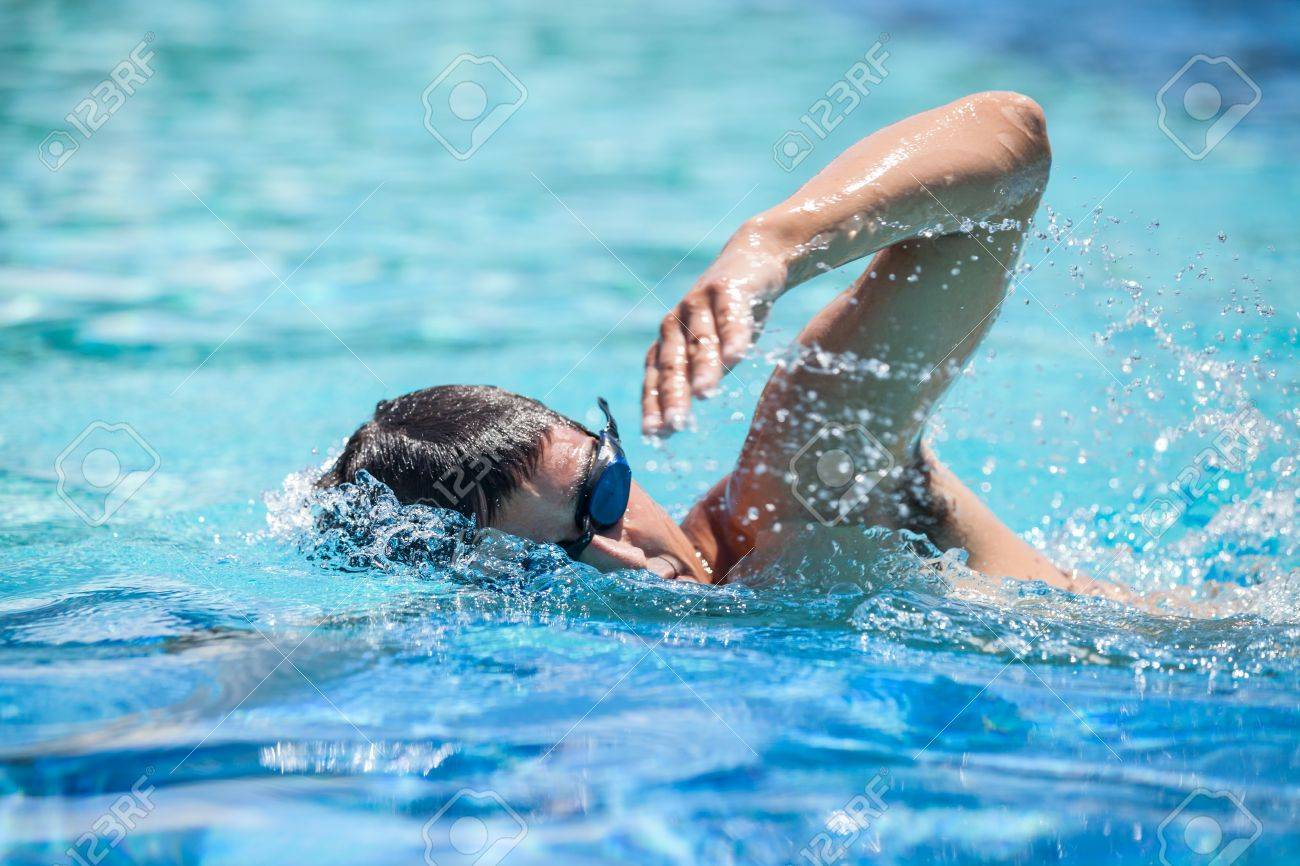 Young Man Swimming The Front Crawl In A Pool Stock Photo, Picture ...