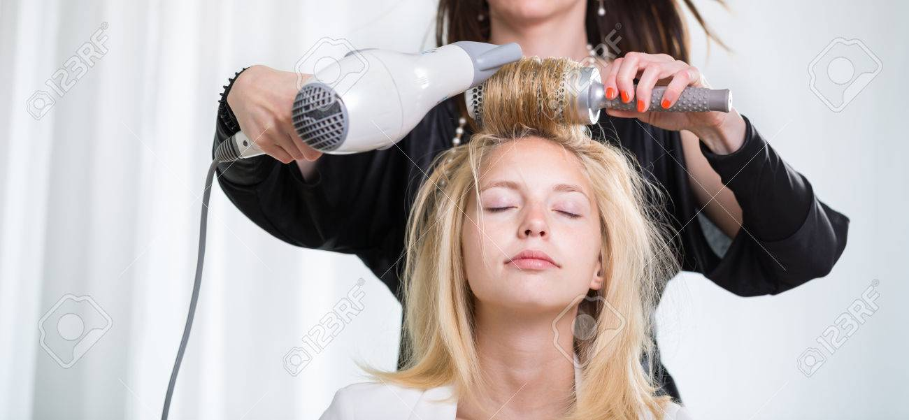 pretty young woman having her hair done by a professional hairstylist stock photo 37882333 - Professional Hairstylist