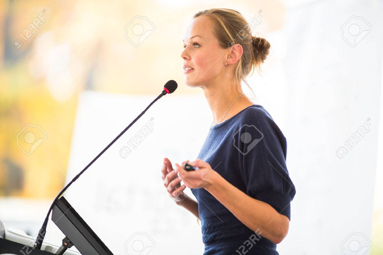 Pretty, young business woman giving a presentation in a conference/meeting setting Standard-Bild - 47887583