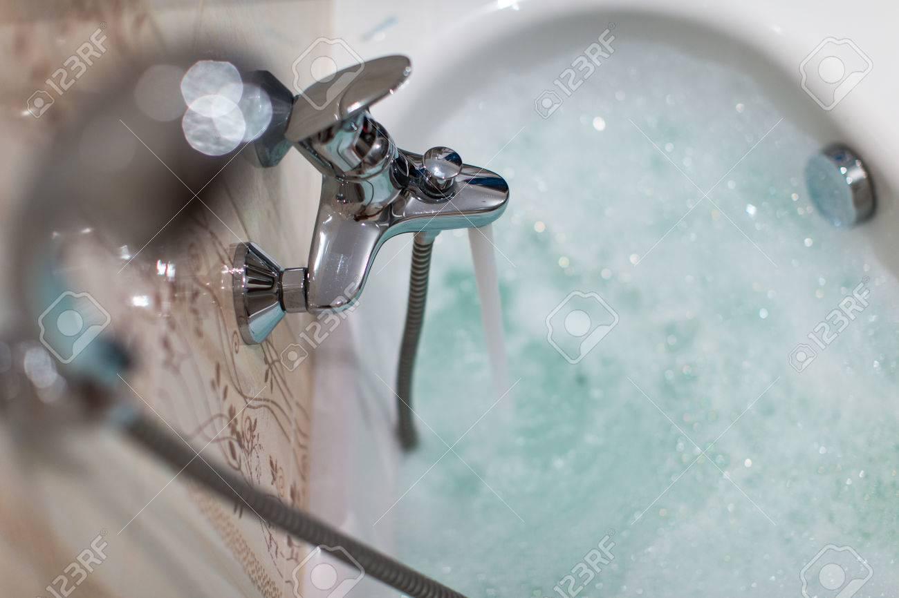 Foamy hot bath in a modern bathroom (shallow DOF; color toned image) Standard-Bild - 49271539