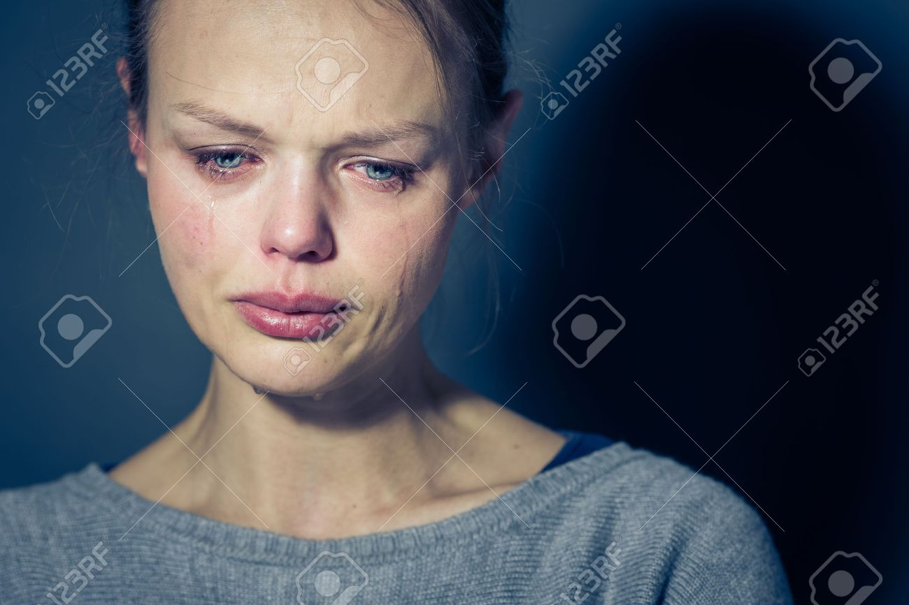 Young woman suffering from severe depression/anxiety/sadness, crying, tears coming from her eyes - 51207681