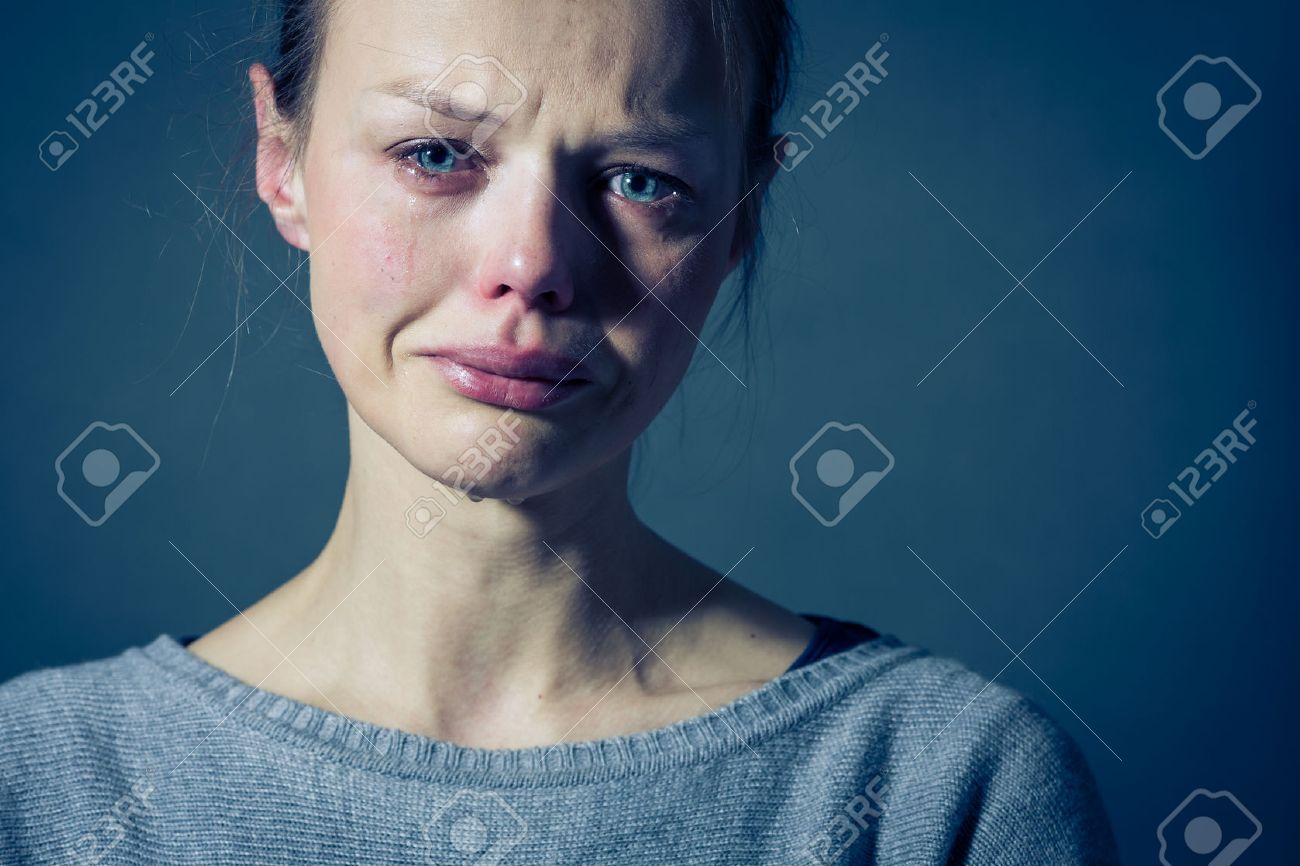 Young woman suffering from severe depression/anxiety/sadness, crying, tears coming from her eyes - 51207852