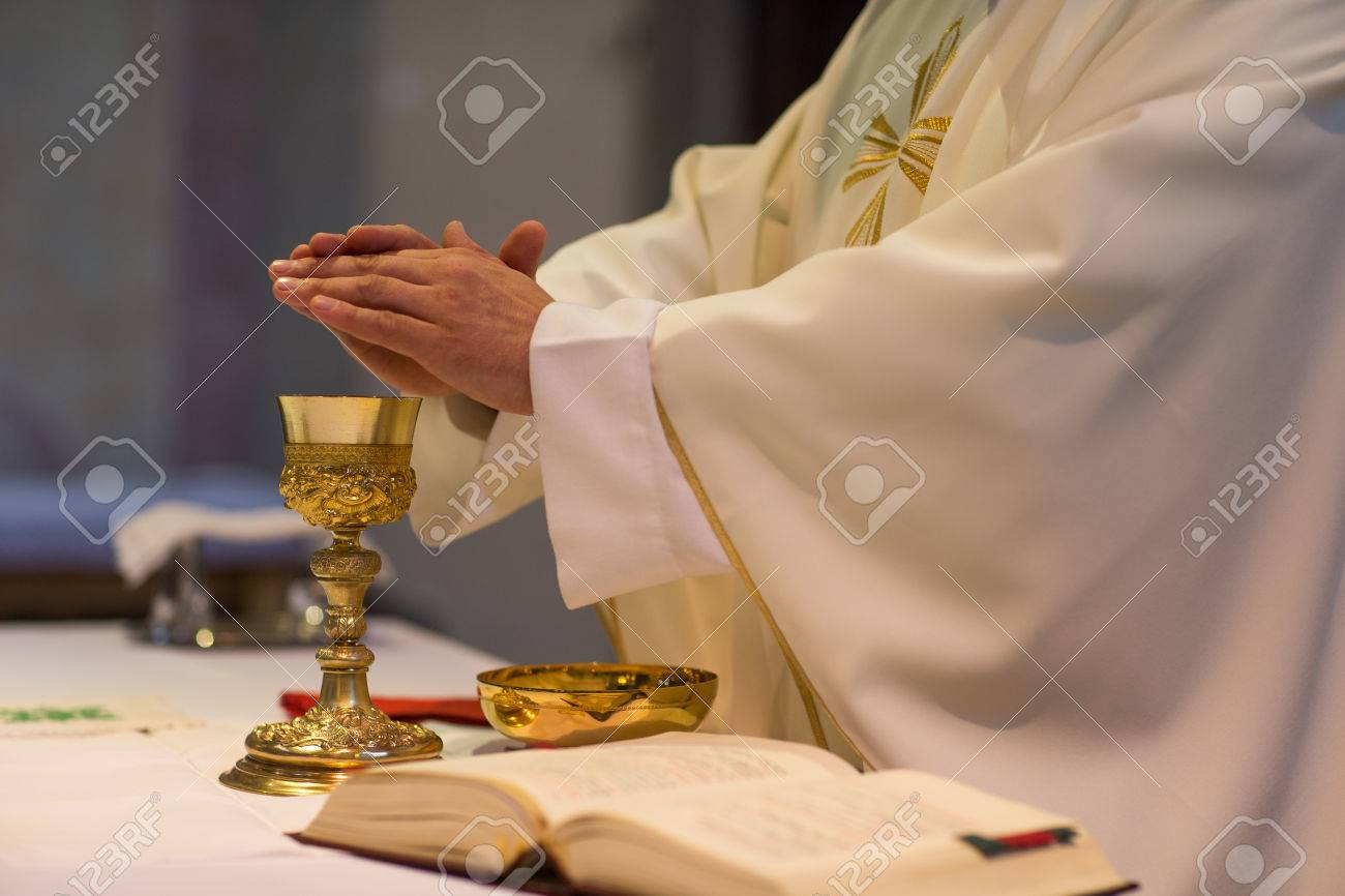 Priest during a wedding ceremony/nuptial mass - 64321374