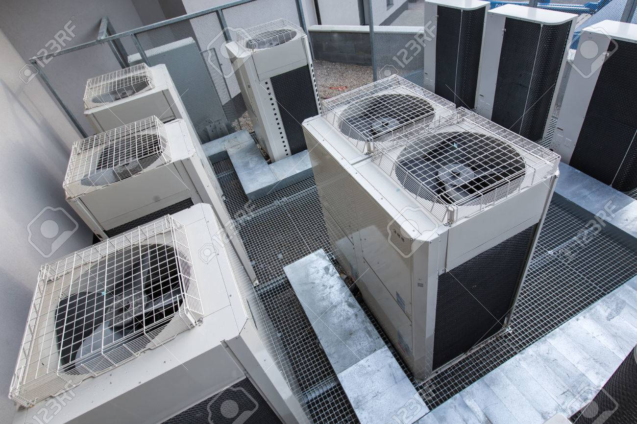 Air conditioning equipment atop a modern building - aerial/drone view of the roof with all the necessary installations Standard-Bild - 66113022