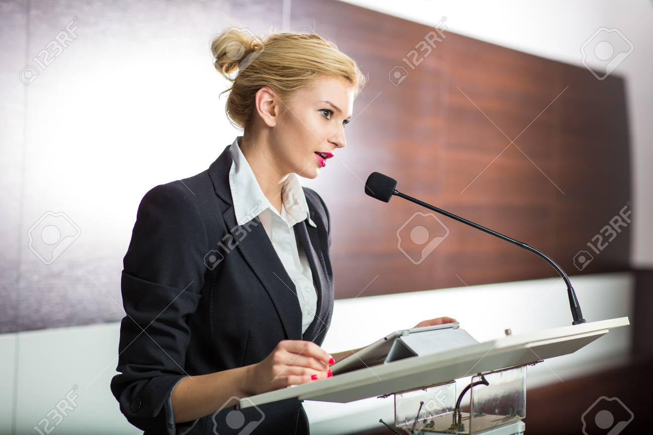 Pretty, young business woman giving a presentation in a conference/meeting setting (shallow DOF; color toned image) - 97894386