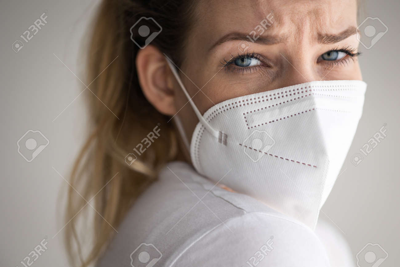 Young woman wearing a face mask during coronavirus and flu outbreak. - 169294165
