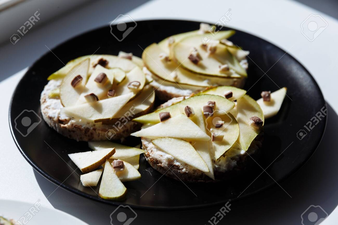 Delicious tartlets or cake with mixed pieces of apples and pears and chocolate from above. Summer pastry desserts. - 145799837