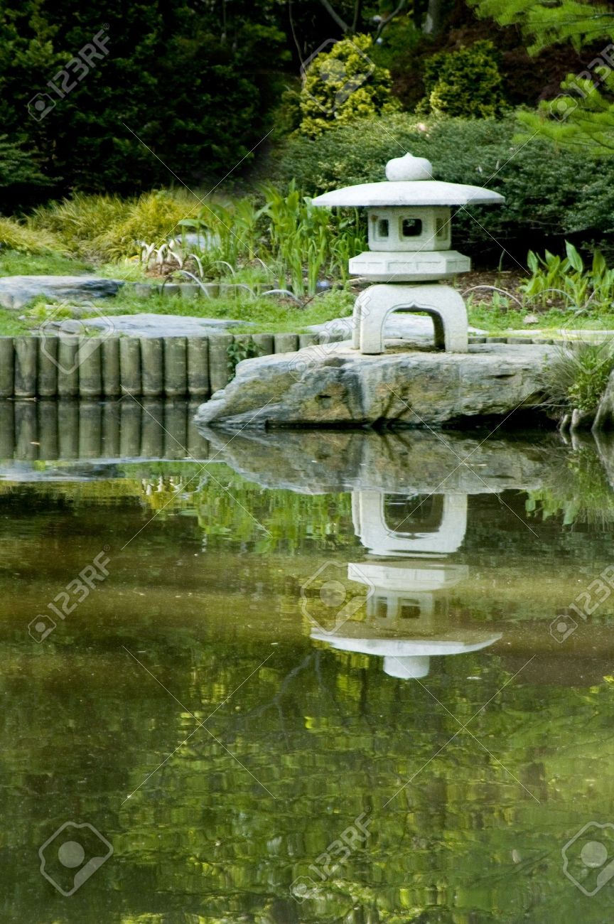 Japanese Zen Garden With Pond pagoda in a japanese zen garden stock photo, picture and royalty