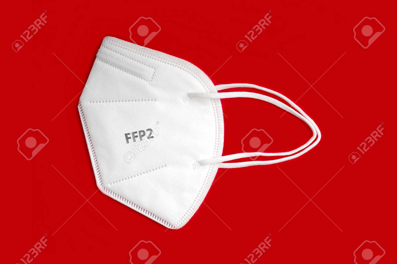 Side view of FFP 2 n95 protective face mask isolated on red background. - 163281517
