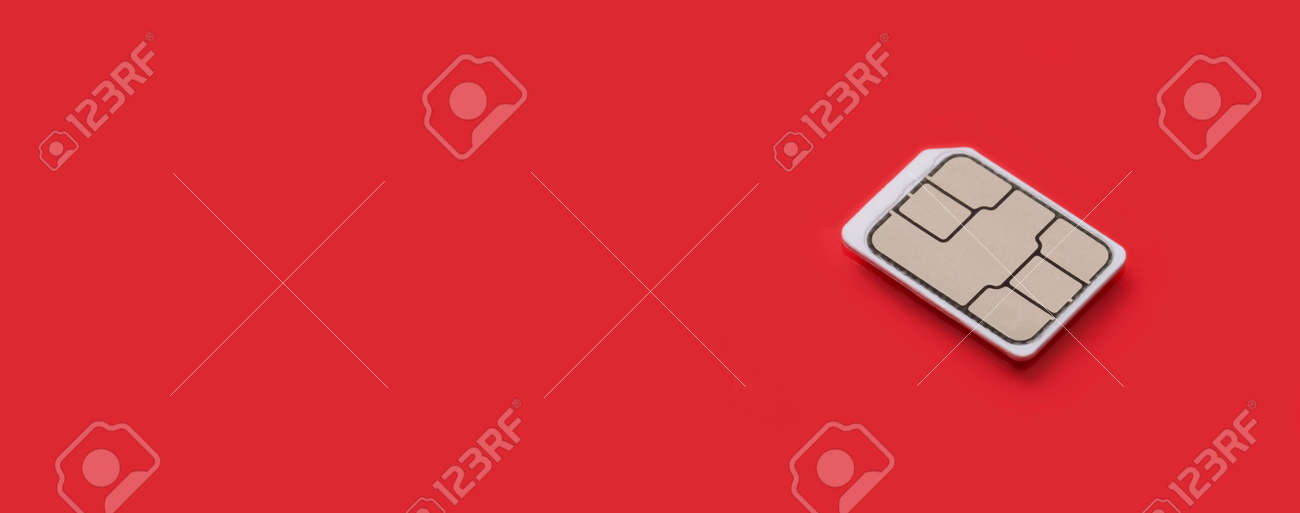 SIM Card - Isolated on red background. banner size, panorama, with copyspace for your individual text. - 163888796