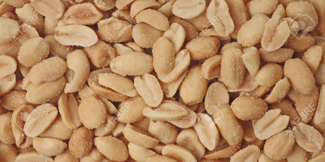 Roasted and salted peanuts. Panoramic background texture. - 163328422