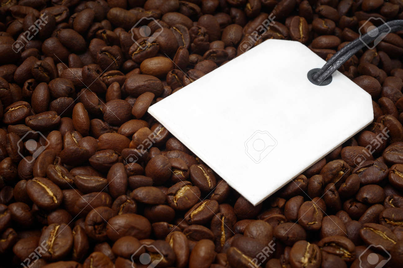 Close-up of a bunch of roasted coffee beans. Horizontal image with label for your individual text. - 164394424