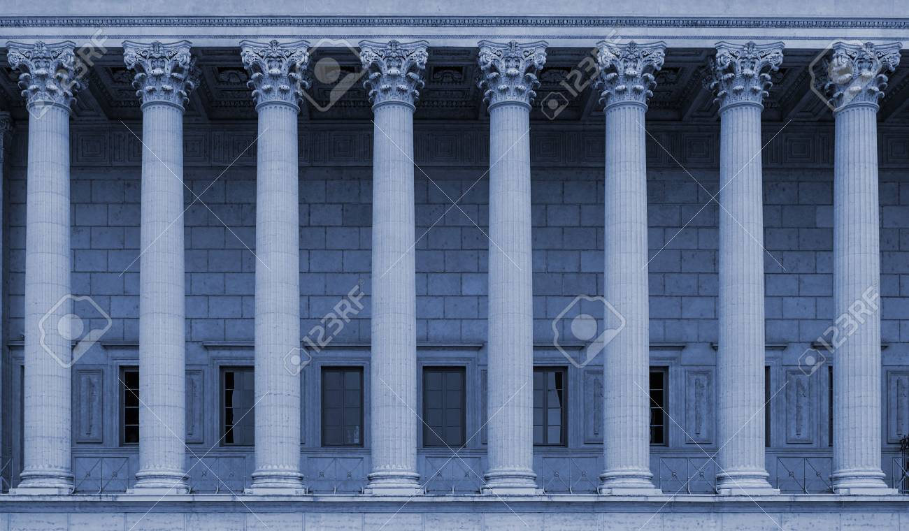 a row of corinthian columns of a public law court in lyon france blue