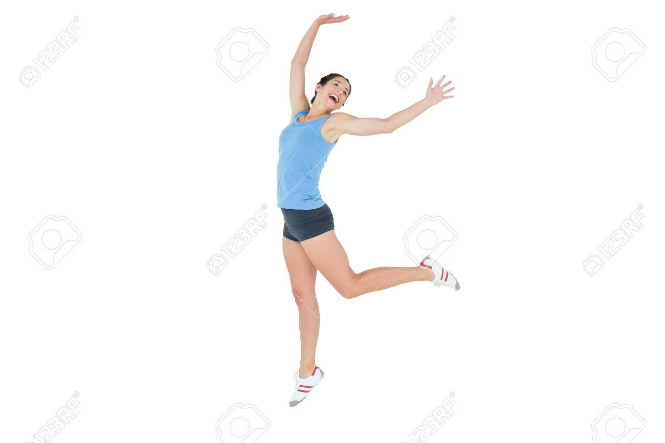 Full length of an active sporty young woman rejoicing over white background Stock Photo - 25451377