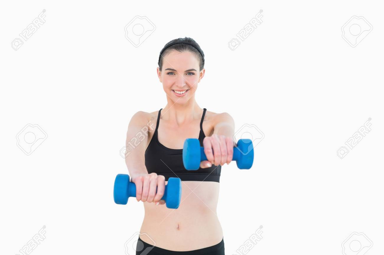 Portrait of a smiling young woman with dumbbells against white background Stock Photo - 25461365
