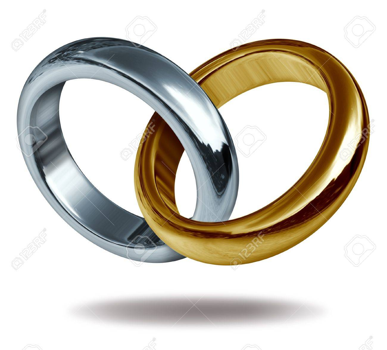 Wedding rings linked together to form a golden and titanium shape