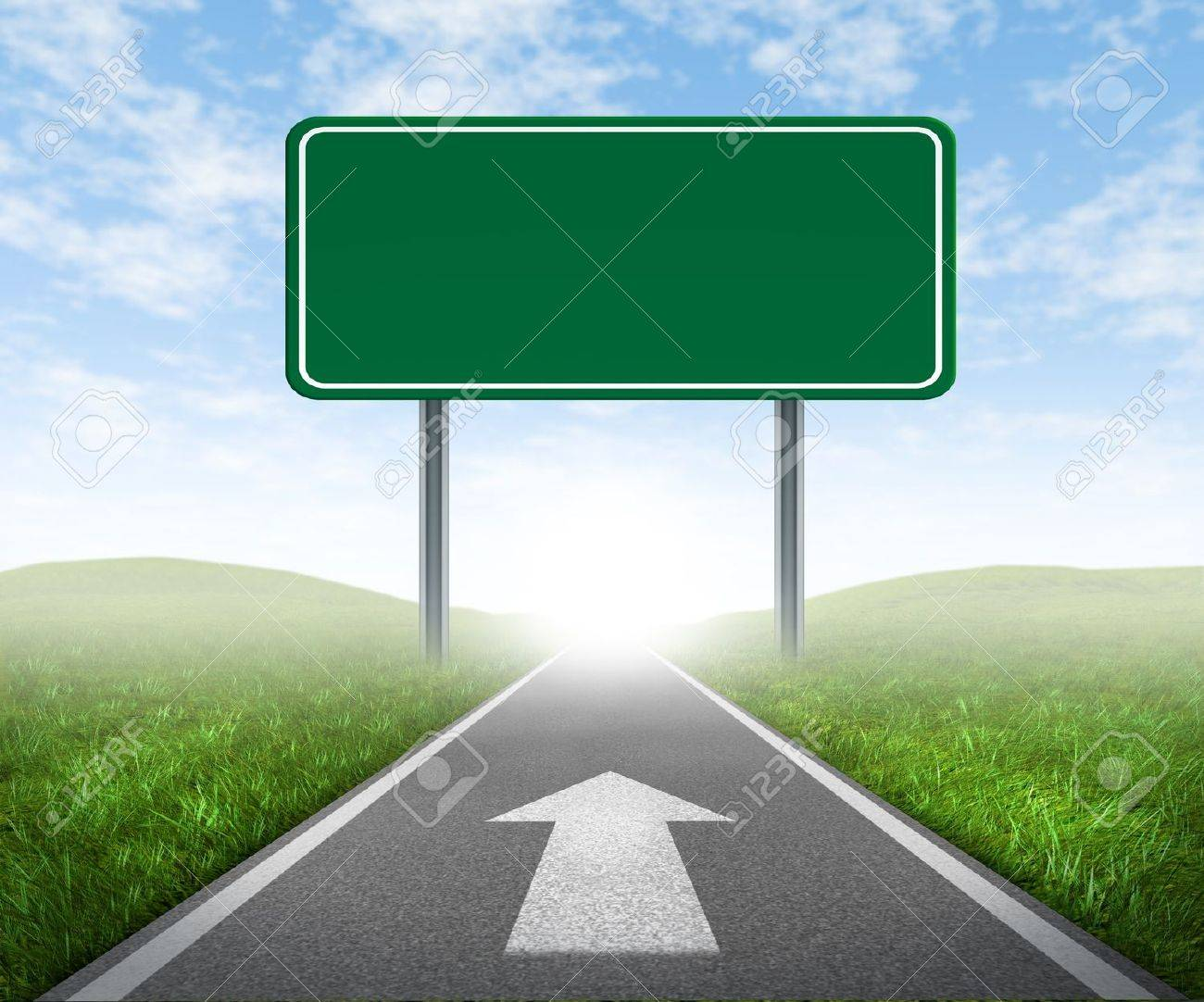 Clear goals on an open straight road highway sign with green grass and asphalt street representing the concept of journey to a focused destination resulting in success and happiness with an arrow on the pavement. Stock Photo - 11221507