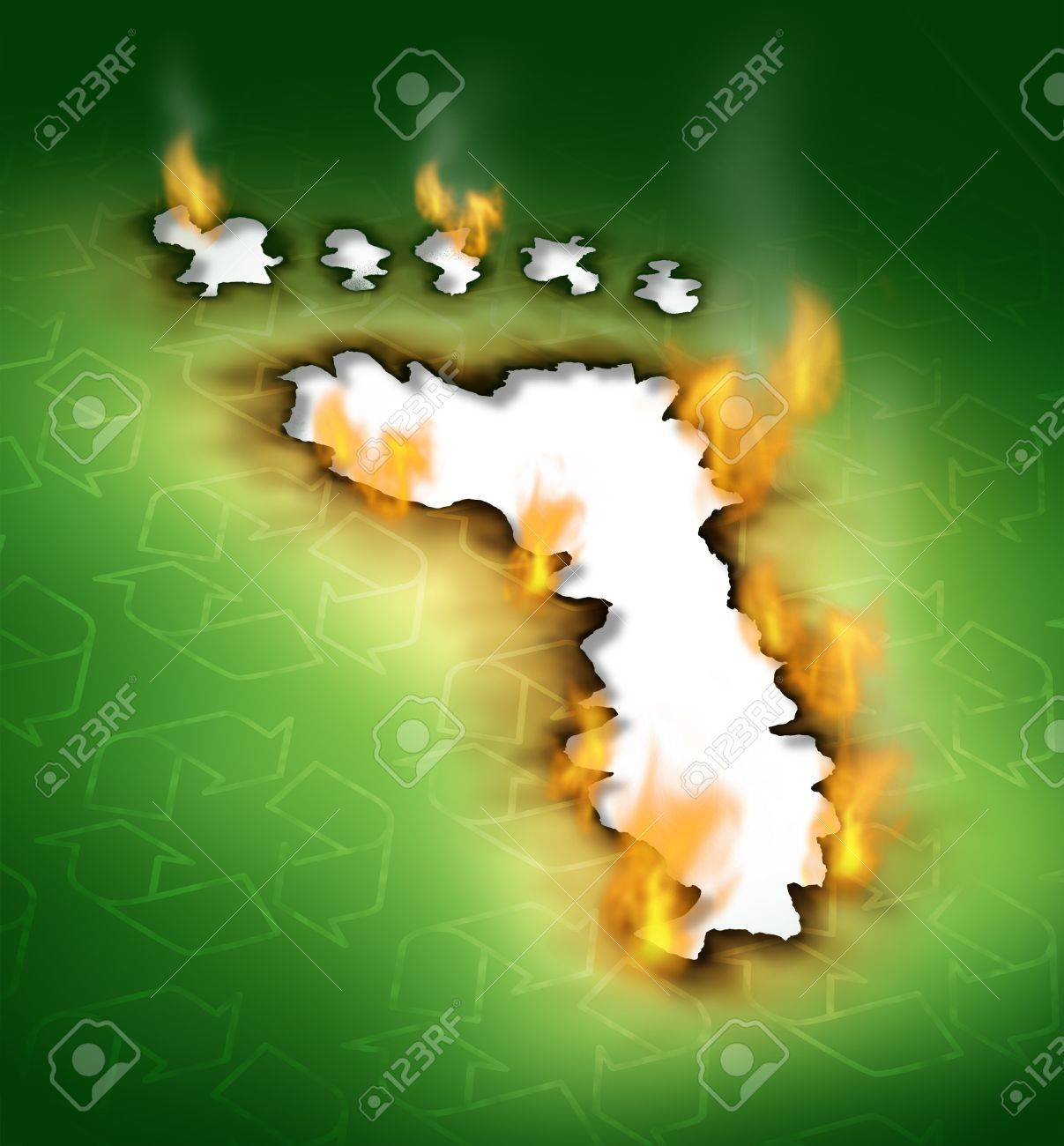 Conservation concept as a footprint hole with smoke damaged burnt green paper edges burning on fire with recycling symbols as an icon of global warming with nature and environmental pollution Stock Photo - 14730976