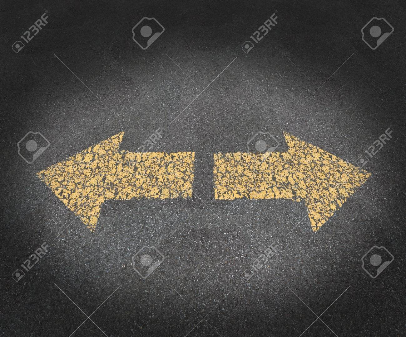 Strategy and decisions concept with a textured asphalt road and two old painted yellow arrows pointing in opposite directions as a business symbol of confusion and uncertainty in the future path ahead Stock Photo - 15206255