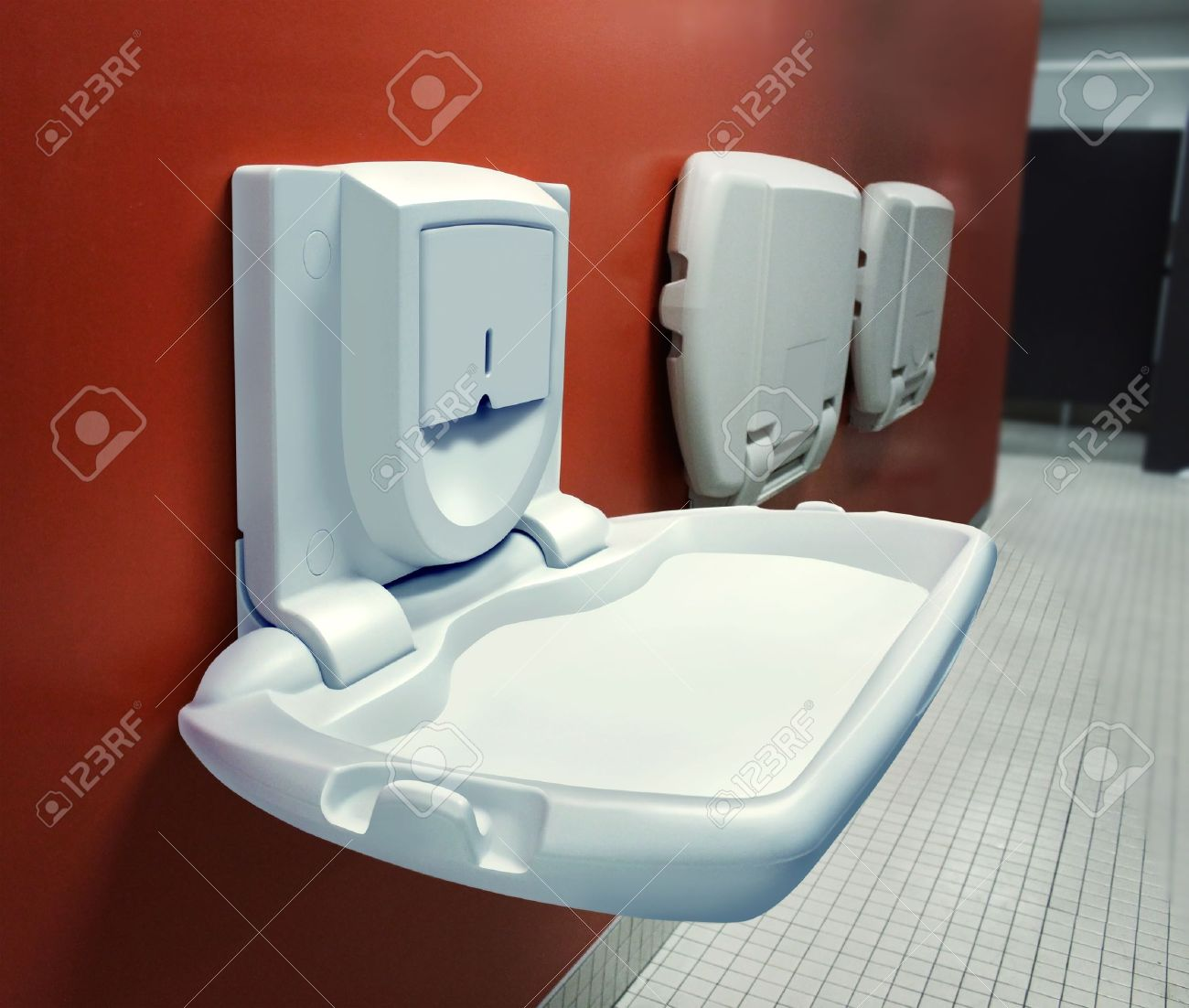 urban parenting with a public diaper changing table mounted on a wall stock photo