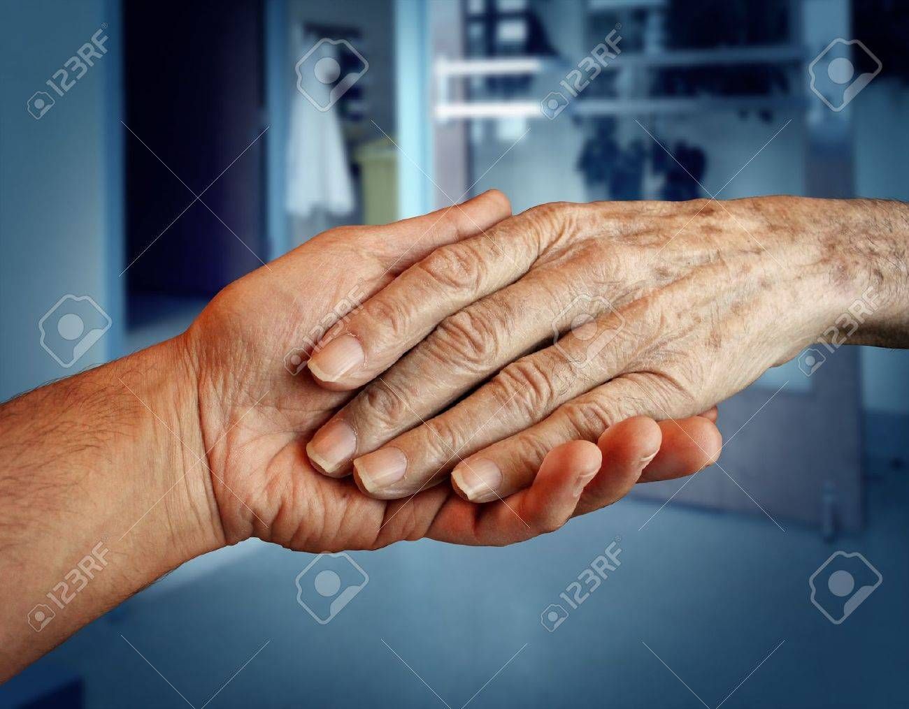 Elderly care and senior health services with the hand of a young person holding and helping an old and aging retired patient needing in home medical help due to aging and memory loss in a hospital background Stock Photo - 17811646